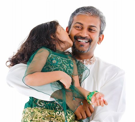 Happy little Indian daughter kissing her father on white background Stock Photo - Budget Royalty-Free & Subscription, Code: 400-06141545