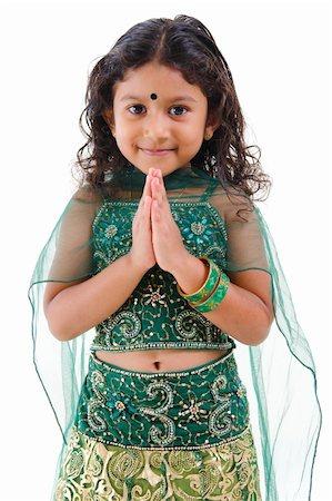Cute little Indian girl in a greeting pose, isolated white background Stock Photo - Budget Royalty-Free & Subscription, Code: 400-06141543