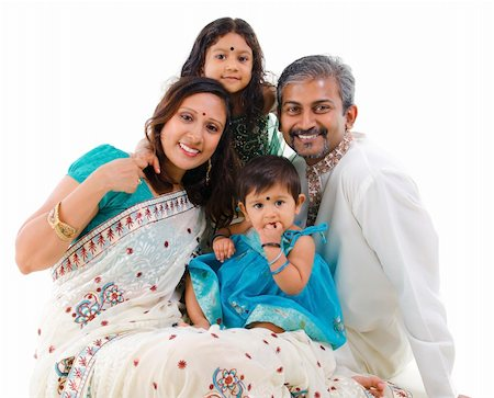 Happy Indian family with two children in traditional costume sitting on white background Stock Photo - Budget Royalty-Free & Subscription, Code: 400-06141558