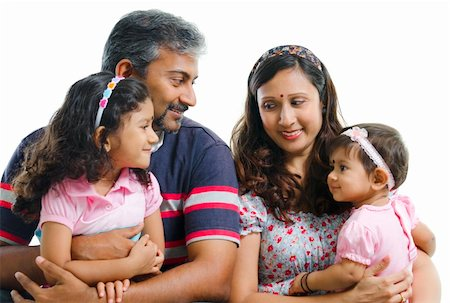 Modern Indian family with two daughter having conversation on white background Stock Photo - Budget Royalty-Free & Subscription, Code: 400-06141564