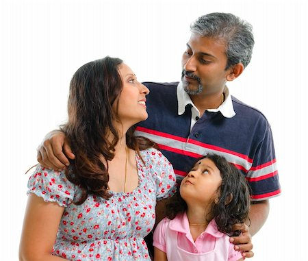 Modern Indian family having conversation on white background Stock Photo - Budget Royalty-Free & Subscription, Code: 400-06141562