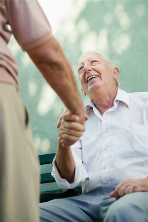 diego_cervo (artist) - Active retirement, two old male friends talking and shaking hands on bench in public park Stock Photo - Budget Royalty-Free & Subscription, Code: 400-06142277