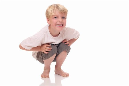 Happy young boy standing on white background Stock Photo - Budget Royalty-Free & Subscription, Code: 400-06142314