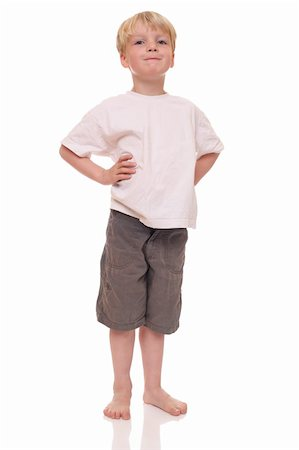 Happy young boy standing on white background Stock Photo - Budget Royalty-Free & Subscription, Code: 400-06142313