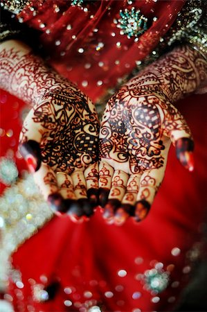 Beautiful henna tattoo in an Indian bride's hand Stock Photo - Budget Royalty-Free & Subscription, Code: 400-06142522