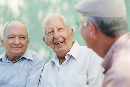 diego_cervo (artist) - Active retirement, group of three old male friends talking and laughing on bench in public park Stock Photo - Budget Royalty-Free & Subscription, Code: 400-06142712