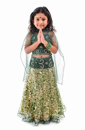 Cute little Indian girl in a greeting pose, isolated white background Stock Photo - Budget Royalty-Free & Subscription, Code: 400-06142827