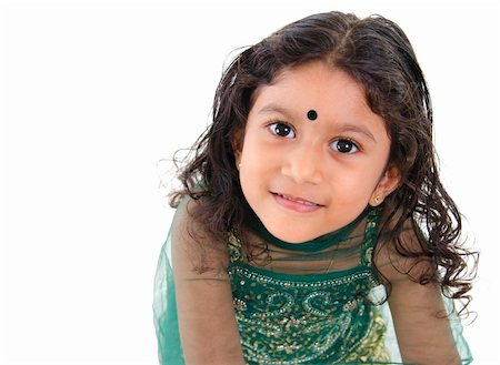 Little Indian girl looking up over white background Stock Photo - Budget Royalty-Free & Subscription, Code: 400-06142828