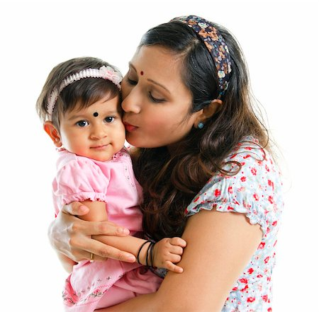daughter kissing mother - Asian Indian mother kissing her baby girl, isolated on white background Stock Photo - Budget Royalty-Free & Subscription, Code: 400-06142848