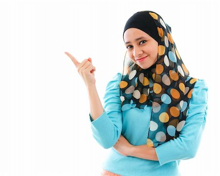 Cute young Muslim woman pointing on empty space, isolated on white Stock Photo - Budget Royalty-Free & Subscription, Code: 400-06142860