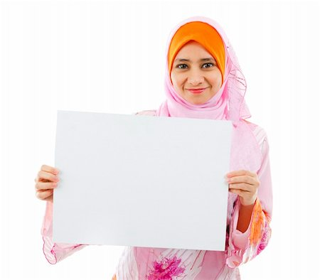 Beautiful Young Muslim girl holding a white card board over white background Stock Photo - Budget Royalty-Free & Subscription, Code: 400-06142862