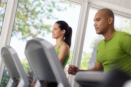 diego_cervo (artist) - Man and woman working out and running on treadmill in fitness club Stock Photo - Budget Royalty-Free & Subscription, Code: 400-06142895