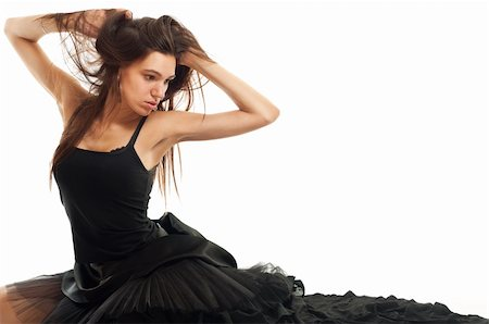 feet gymnast - female ballet dancer in black dress holding her hair isolated on white Stock Photo - Budget Royalty-Free & Subscription, Code: 400-06174529