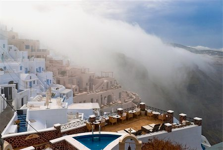 Santorini buildings and cliffs in the morning fog Stock Photo - Budget Royalty-Free & Subscription, Code: 400-06174798