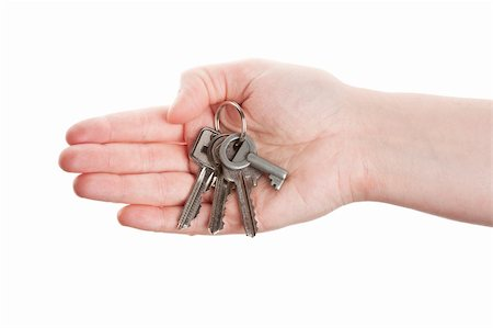 finger holding a key - Hand and keys isolated on white background Stock Photo - Budget Royalty-Free & Subscription, Code: 400-06175791