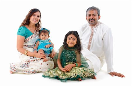 female white background full body - Happy Indian family sitting on white background Stock Photo - Budget Royalty-Free & Subscription, Code: 400-06176896
