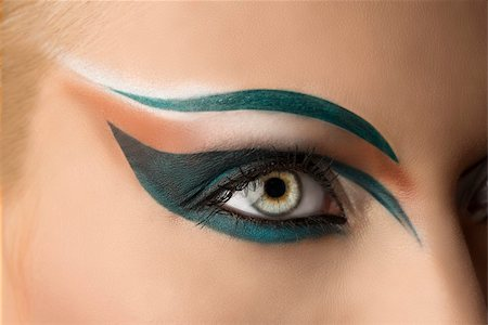 girl's eye closeup with creative green makeup. it's open Stock Photo - Budget Royalty-Free & Subscription, Code: 400-06177382