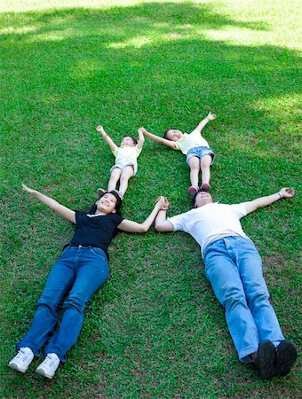 family fun day background - asian family lying on the grass Stock Photo - Budget Royalty-Free & Subscription, Code: 400-06171252