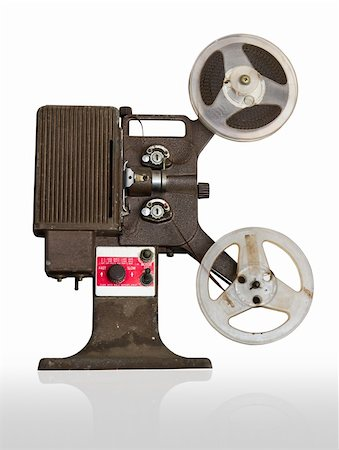 Analogue  movie projector with reels isolate on white background Stock Photo - Budget Royalty-Free & Subscription, Code: 400-06171771