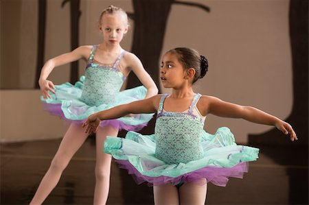Two adorable children twirling during ballet practice Stock Photo - Budget Royalty-Free & Subscription, Code: 400-06172147