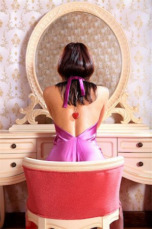 beautiful young lady at mirror admires reflexion in the bedroom Stock Photo - Budget Royalty-Free & Subscription, Code: 400-06202643