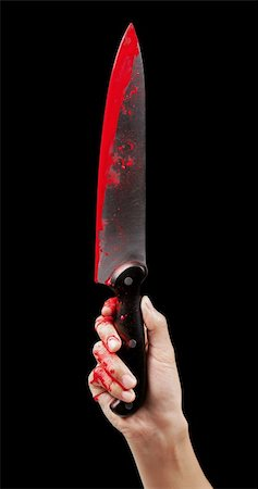 A bloody hand holding a large blood covered knife on a black isolated background. Stock Photo - Budget Royalty-Free & Subscription, Code: 400-06203279