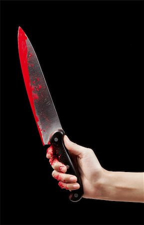 A bloody hand holding a large blood covered knife on a black isolated background. Stock Photo - Budget Royalty-Free & Subscription, Code: 400-06203281