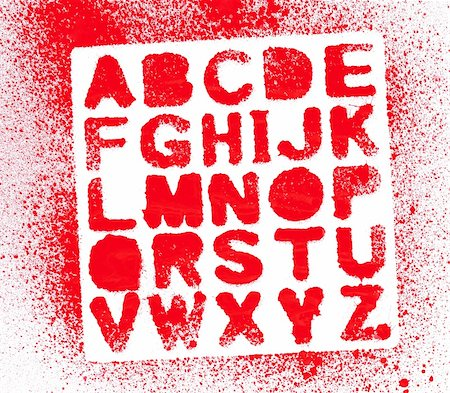 A stenciled out set of the alpabet shot on white paper with lots of red spatter. Stock Photo - Budget Royalty-Free & Subscription, Code: 400-06203299