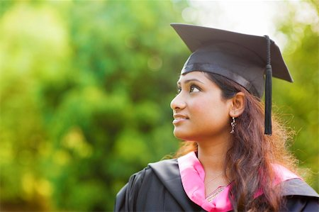 Smiling Young Asian Indian female student looking away with copy space Stock Photo - Budget Royalty-Free & Subscription, Code: 400-06328861