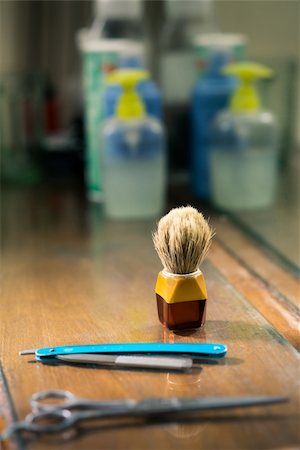diego_cervo (artist) - Closeup of barber tools, shaving brush, scissors and razor on shelf in barber shop Stock Photo - Budget Royalty-Free & Subscription, Code: 400-06330957