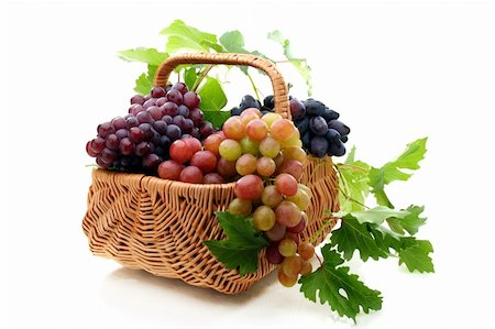 Basket with pink and black grapes on white background. Stock Photo - Budget Royalty-Free & Subscription, Code: 400-06361386