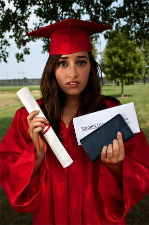 education loan - Graduate holding diploma, checkbook and student loan bill. This is a conceptual image about student loans and debt. Stock Photo - Budget Royalty-Free & Subscription, Code: 400-06363676