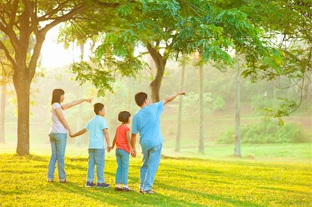 family fun day background - Candid Asian family pointing at outdoor park Stock Photo - Budget Royalty-Free & Subscription, Code: 400-06363757