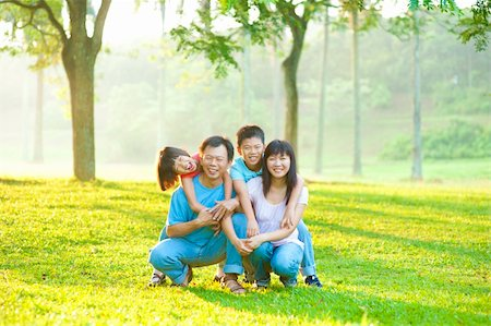 family fun day background - Asian family portrait at outdoor park Stock Photo - Budget Royalty-Free & Subscription, Code: 400-06363758