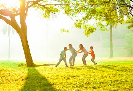 family fun day background - Happy Asian family playing together at outdoor park Stock Photo - Budget Royalty-Free & Subscription, Code: 400-06363767