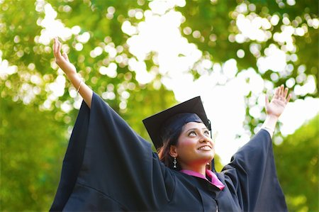 Young Asian Indian female student open arms outdoor on graduation day Stock Photo - Budget Royalty-Free & Subscription, Code: 400-06387452