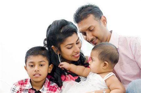 Loving Indian family at home Stock Photo - Budget Royalty-Free & Subscription, Code: 400-06389661