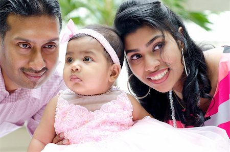 Indian parents and baby girl at outdoor home garden Stock Photo - Budget Royalty-Free & Subscription, Code: 400-06389662