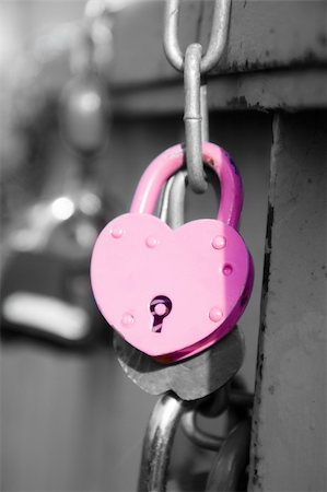 pzromashka (artist) - pink wedding lock hanging on the bridge Stock Photo - Budget Royalty-Free & Subscription, Code: 400-06394877