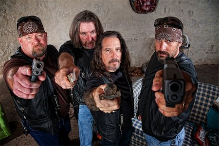 Group of four bikers in leather jackets brandishing weapons Stock Photo - Budget Royalty-Free & Subscription, Code: 400-06396524