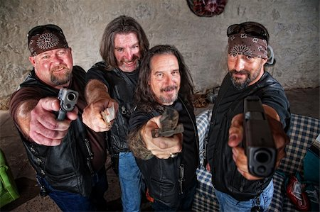 Smiling group of Caucasian bikers in leather jackets with weapons Stock Photo - Budget Royalty-Free & Subscription, Code: 400-06396525