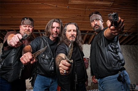 Four tough middle aged white gang members with weapons Stock Photo - Budget Royalty-Free & Subscription, Code: 400-06396526