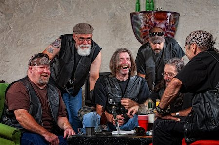 Six male biker gang members laughing with weapons on table Stock Photo - Budget Royalty-Free & Subscription, Code: 400-06396527