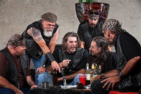 Biker gang members talking and drinking with weapons Stock Photo - Budget Royalty-Free & Subscription, Code: 400-06396529