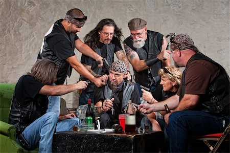 Biker gang members threatening man in bandana Stock Photo - Budget Royalty-Free & Subscription, Code: 400-06396534