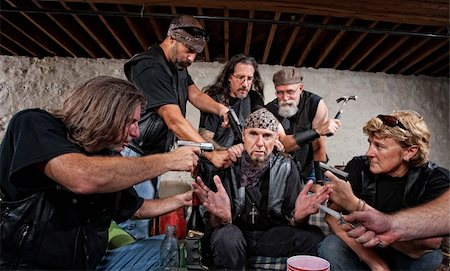 Group of bikers in leather hold up sitting man Stock Photo - Budget Royalty-Free & Subscription, Code: 400-06396536