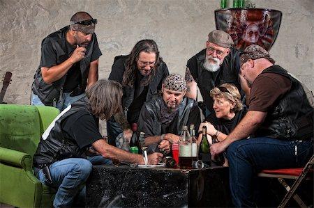 Seven biker gang members writing a plan indoors Stock Photo - Budget Royalty-Free & Subscription, Code: 400-06396533