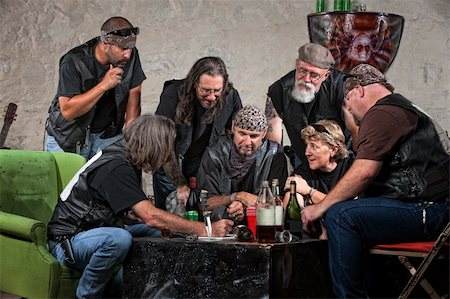 Seven biker gang members writing a plan indoors Stock Photo - Budget Royalty-Free & Subscription, Code: 400-06396533