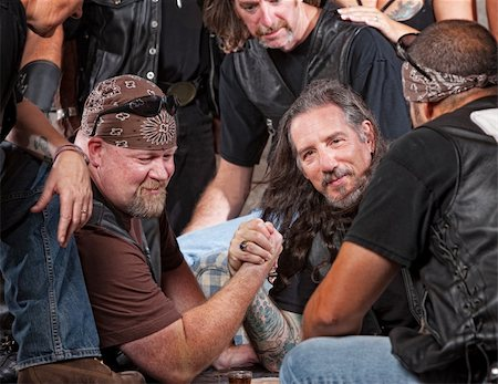 Tough male gang members in arm wrestling match Stock Photo - Budget Royalty-Free & Subscription, Code: 400-06396545