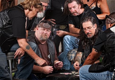 Serious gang members playing cards and drinking Stock Photo - Budget Royalty-Free & Subscription, Code: 400-06396838